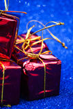 Gift packages on bright blue background Stock Image