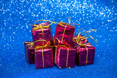 Gift packages on bright blue background Stock Photos