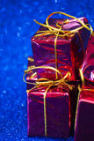 Gift packages on bright blue background Royalty Free Stock Photography