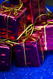 Gift packages on bright blue background Royalty Free Stock Photos