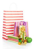 Gift packages with christmas tinsel Royalty Free Stock Images