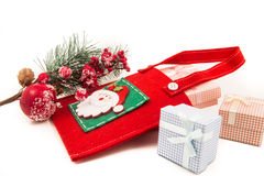 Gift packages colored  and Christmas-accessories  on white. Gift packages colored  and Christmas-accessories Stock Photos