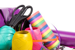 Gift packaging. Scissors, ribbons, bows, paper, streamers isolated on white stock photo