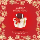 Gift packaging with a ball for American football and gold ribbons and a red bow on the background of snowflakes. Festive greeting Stock Photography