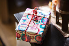 Gift packaging. Gift box on the table Stock Image