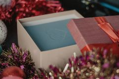 Free Gift Packaging. Open Christmas Box With Garland And Balls Royalty Free Stock Photos - 126269898