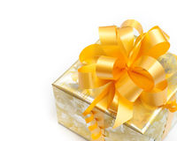 Gift packed in golden paper on white stock photo