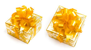 Gift packed in golden paper with yellow bow royalty free stock image