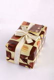 Gift. Packed in paper with chocolate bombons Royalty Free Stock Images