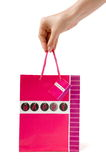 Gift packet. Red gift present packet with handles holding by hand inscription happy Royalty Free Stock Images