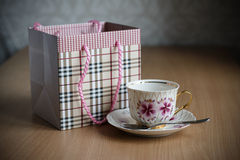 Gift packet and cup with a saucer Stock Image