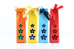 Gift packets with flowers, on white Royalty Free Stock Photo