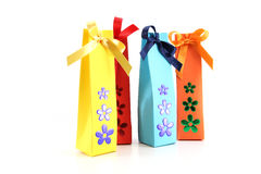 Gift packets with flowers, on white Royalty Free Stock Image