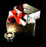 Black,background,gift packs, xmas. Gift packs with candle and gift card Royalty Free Stock Photos