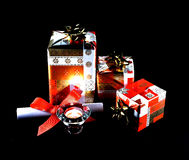 Black,background, Gift packs,candle,xmas. Gift packs with gift card Royalty Free Stock Photo