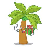 With gift palm tree character cartoon Stock Photography