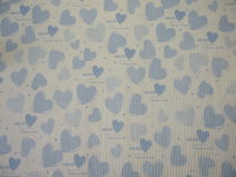 Gift paper. Blue gift paper with hearts Royalty Free Stock Photo
