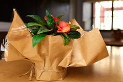 Gift paper flowers. On the table Royalty Free Stock Photo