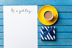 Gift and paper with Good day inscription Royalty Free Stock Images