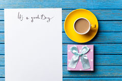 Gift and paper with Good day inscription Royalty Free Stock Image