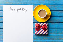 Gift and paper with Good day inscription Stock Photos