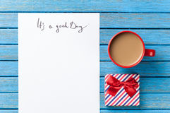 Gift and paper with Good day inscription Stock Image