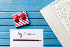 Gift and paper with My Business words near notebook Royalty Free Stock Images