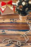 Gift paper package with red golden bow on wooden table Copy spac Royalty Free Stock Photography