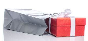 Gift with paper shopping bag Stock Photos