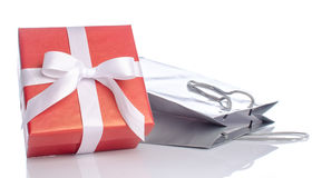 Gift with paper shopping bag Royalty Free Stock Photo