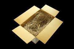 Gift papper box with decorative straw, filler, royalty free stock image