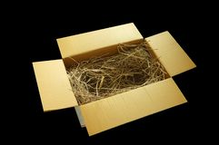 Gift papper box with decorative straw, filler, royalty free stock images