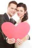 Gift par med hjärtateckensymbol Arkivbild