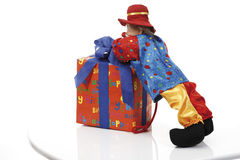 Gift parcel and clown figurine Royalty Free Stock Photography