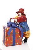 Gift parcel and clown figurine Royalty Free Stock Image