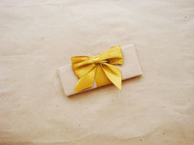 Gift or parcel on a wooden Royalty Free Stock Photos