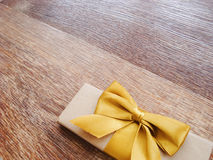 Gift or parcel on a wooden Stock Image