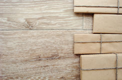 Gift or parcel on a wooden Royalty Free Stock Images