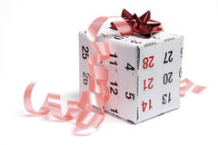 Gift Parcel Wrapped with Calendar Page Royalty Free Stock Photography