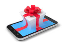 Gift on phone. Gift on phone over white Royalty Free Stock Photos