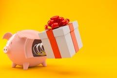 Gift with piggy bank Stock Photos