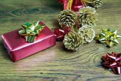 Gift and pine cones Stock Image