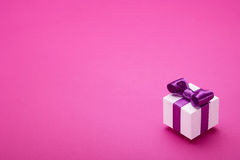 Gift on a pink background Stock Images