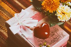 Gift in pink box with red heart. Retro style toned image Royalty Free Stock Photography