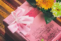 Gift in pink box. Retro style toned image Stock Image