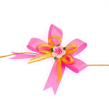 Gift pink ribbon and bow  on white background Royalty Free Stock Photo