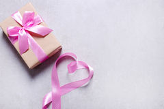 Gift with pink ribbon Stock Images
