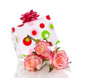Gift and pink roses Royalty Free Stock Photo