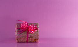 Gift With Pink Satin Bow Royalty Free Stock Image