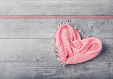 Gift pink silk scarf in the form of heart Royalty Free Stock Image